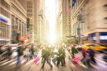 People Walking On 7 Th Av. And West 34 Th Crossroad In Manhattan Before Sunset - Crowded Streets Of New York City On Rush Hour In Urban Business Area - Radial Blur Composition With Focus On Background