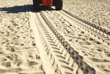 Wheel Tracks On A Sandy Beach