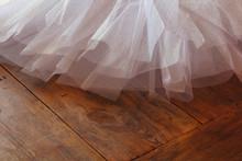 White Ballet Tutu On Wooden Floor