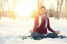 Attractive Mixed Race Woman Doing Yoga In Nature At Winter Time