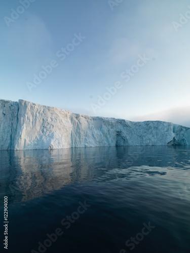 Big icebergs are ont he arctic ocean in Greenland