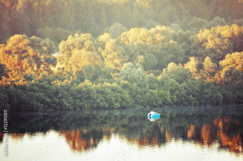 In de dag Khaki Autumn sunny landscape-birds eye view of autumn yellowed forest and river with boat at early autumn morning