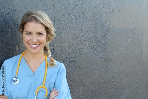 Fotografia  Beautiful young doctor with stethoscope and copy space for text