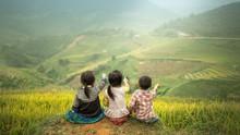 Three Children Sitting Side By...