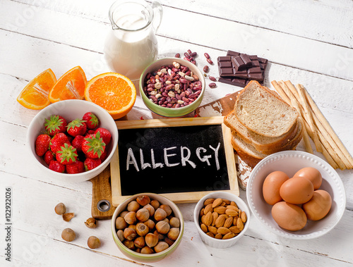 Food allergy. Allergic food on  wooden background. Canvas Print