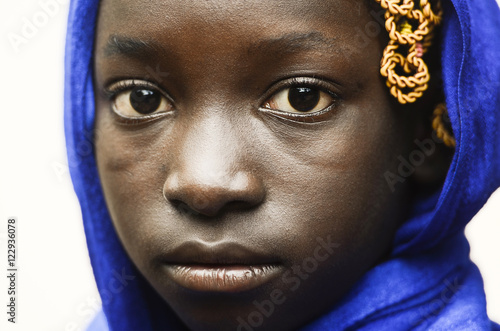 Sadness and Despair Symbol - Cute African School Girl With a Blue Headscarf