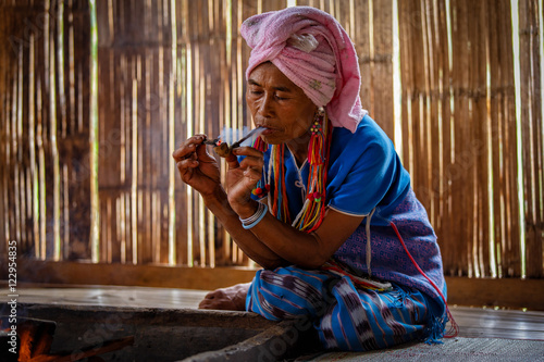 Cuadros en Lienzo Female karen hill tribe is smoking tobacco pipe traditional in the cottage of no
