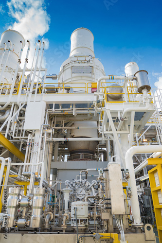 Fototapety, obrazy: Oil and gas business, offshore oil and gas processing platform, feed gas turbine compressor and west heat recovery unit at the top of deck floor.