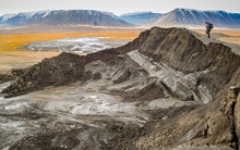Explorer On Top Of Burst Pingo In A Permafrost Arctic Landscape