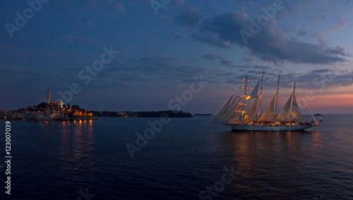 A beautiful sailboat sails into the peaceful harbor of Rovinj, a small town in the Istria portion of Croatia © mtilghma