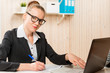 Business woman with black glasses working at a computer