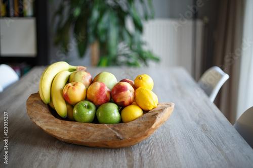 Keuken foto achterwand Vruchten Wooden fruit basket on table