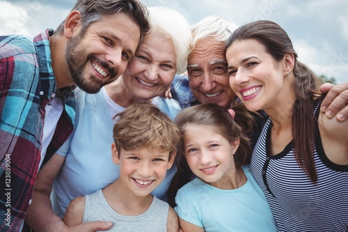 Fotografie, Obraz  Happy multi-generation family standing  outdoors