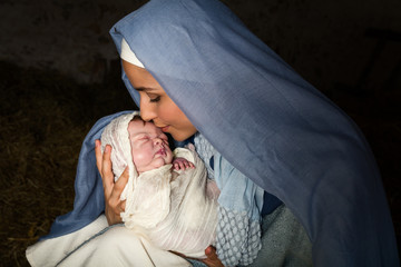 Mary kissing baby Jesus