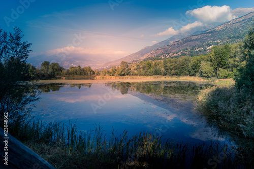 Foto auf Gartenposter Reflexion mountains, sky and clouds reflected in the lake