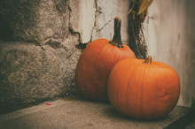 Halloween Autumn Holiday Decoration At The Stone Stairs. Red Pumpkins Against Grunge Wall, Seasonal Background