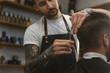 barber cutting hair of a man