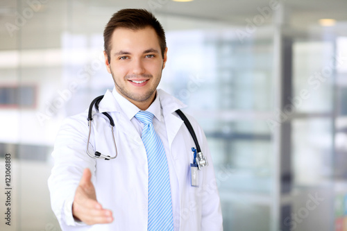 Fototapety, obrazy: Smiling doctor is offering helping hand