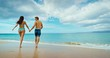 Happy romantic young couple walking and playing on the beach