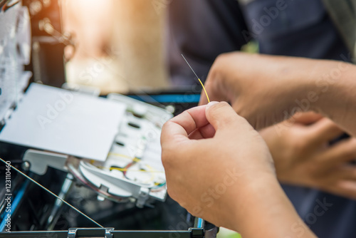 Technicians are install cabinet on fiber optic cable. Canvas Print