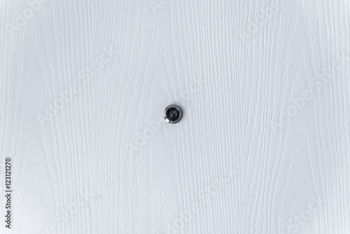 Close Up White Wood And Door Peephole On Texture