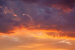 Leinwandbild Motiv Fiery vivid sunset sky clouds