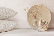 Soft Home Decor Of  Glass Vase With Spikelets And Pillows On White Wood Background. Interior.