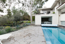Crazy Paving Beside Swimming Pool In Mid Century Modern Home