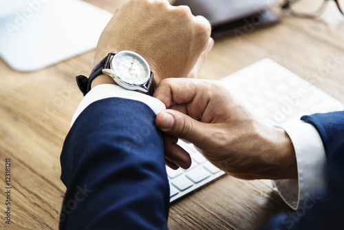 Fotografie, Obraz  Business Man Check Time Delay Concept