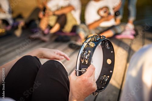 Fotografie, Obraz Person playing tambourine