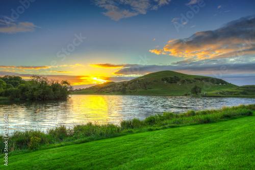 Foto op Plexiglas Groene Idyllic sunset scenery at Lough Gur lake in Ireland