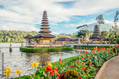 Pura Ulun Danu Bratan, Hindu temple surrounded by flowers on Bratan lake is a major Shivaite and water temple in Bali, Indonesia. Asia landmark