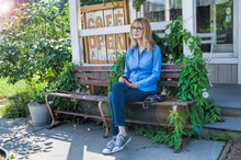 Woman Resting On Cafe Bench