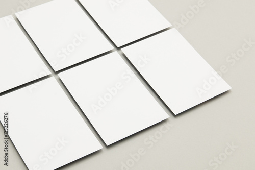Fotografia  Blank white postcard flyer on a grey backgound