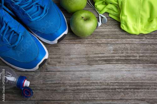 Sport stuff on wooden table, top view Wallpaper Mural