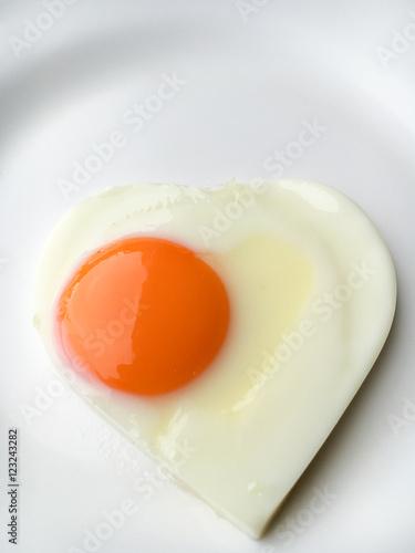 Foto op Aluminium Gebakken Eieren heart-shaped fried eggs on a plate