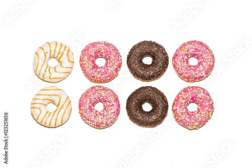 Photo  Colorful glazed donuts isolated on white background, top view
