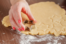 Cooking And Home Concept - Close Up Of Female Hands Making Cooki