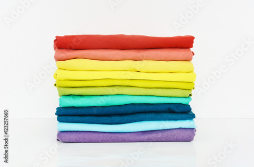 Fotografía stack of colorful t-shirt on white background, copy space
