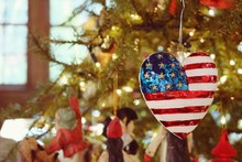 Heart Shaped United States Flag Ornament Hanging On Christmas Tr
