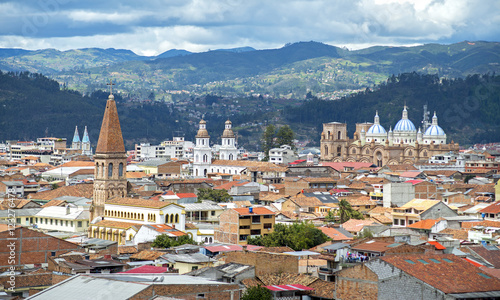 View of the city of Cuenca, Ecuador, with it's many churches and rooftops, on a cloudy day