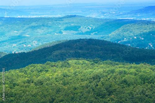 Foto op Aluminium Blauw Scenery of rolling hills landscape.