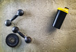 Fitness or bodybuilding background. Old iron dumbbells on conrete floor in the gym. Photograph taken from above, top view