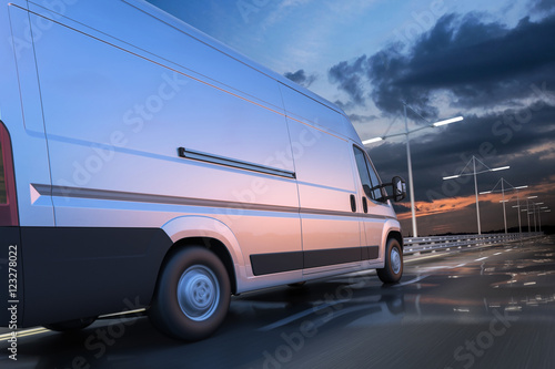 Fotografie, Obraz  3d rendering of generic van on the road at dawn