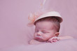 newborn girl in a pink hat