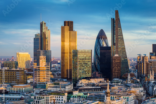 Fototapeta London, England - Business district with famous skyscrapers and landmarks at golden hour obraz na płótnie