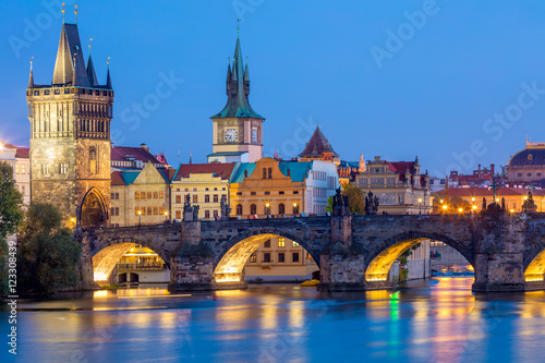 Poster Prague Famous Prague Landmarks - towers and bridge at night