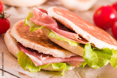 Tigella bread stuffed with ham and lettuce.