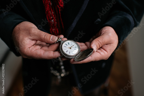 Man holding pocket watch