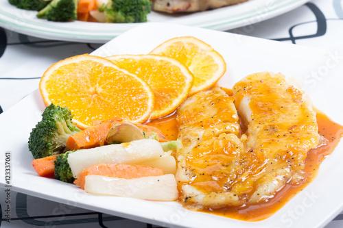 Photo  Dory fish steak with orange sauce
